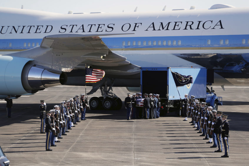 The remains of President George H.W. Bush are loaded onto Special Air Mission 41 by a military honor guard before flying to Washington D. C. on December 3, 2018 in Houston, Texas.
