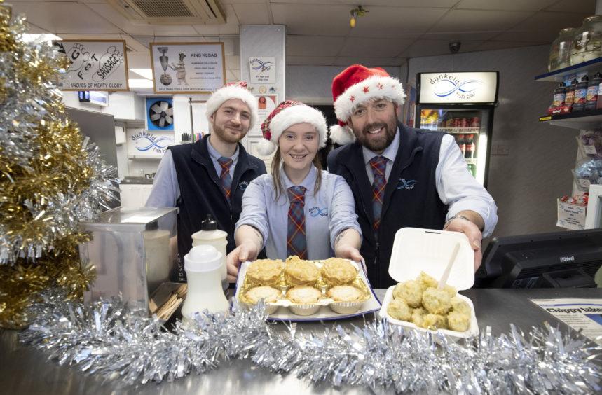 (L-R) Ryan Seager, Chelsea McGowan and owner Scott Davie show off some of the deep-fried Christmas treats.