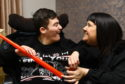 Adam Meldrum with his mum Lynne Scott at home in Kirkcaldy