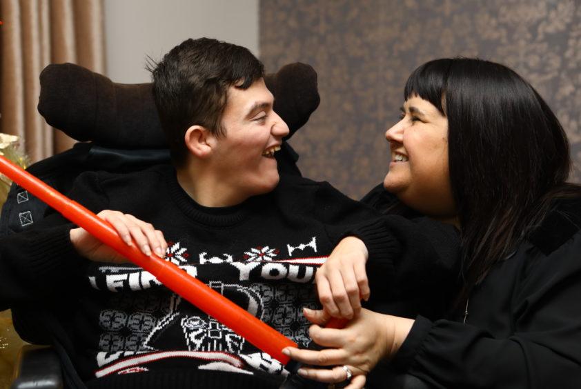 Adam Meldrum with his mum Lynne Scott at home in Kirkcaldy