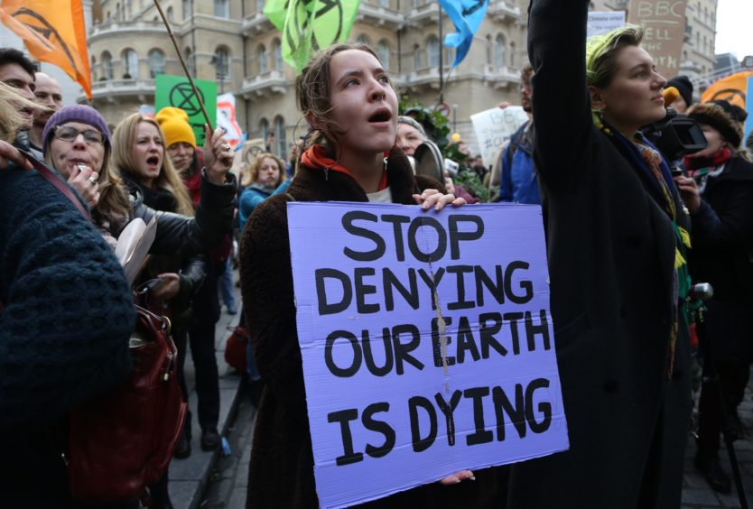 Environmental protesters of Extinction Rebellion group take part in a demonstration outside BBCs headquarters in London on December 21