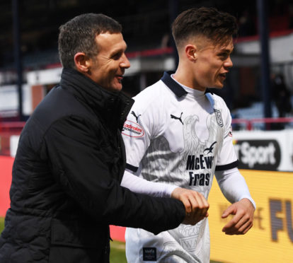 Dundee manager Jim McIntyre with Jesse Curran at full-time on Sunday.