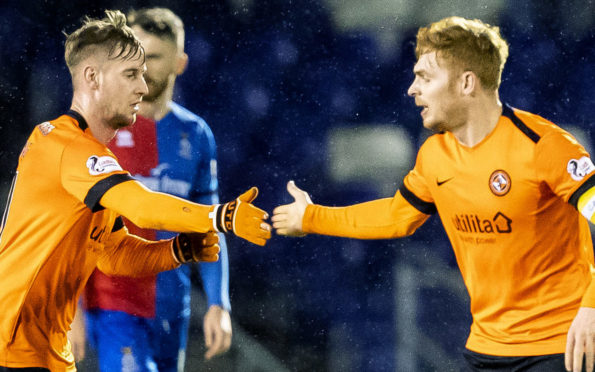 Billy King celebrates with Fraser Fyvie.