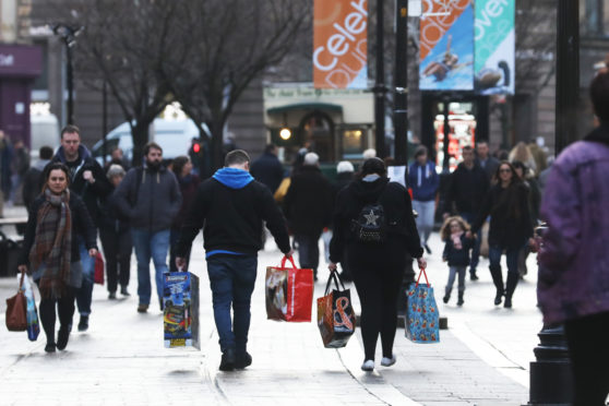 Shoppers Hit The Stores For Last Minute Christmas Gift Shopping