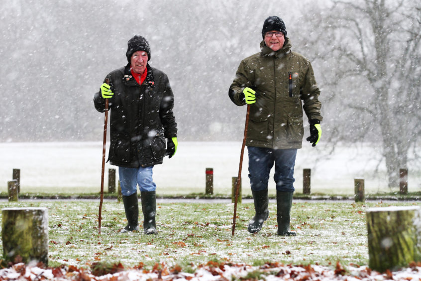 Brothers Jimmy and Harry Fraser from Lochee and Menziehill too a walk in the snow at Camperdown Park. Mhairi Edwards/DCT Media