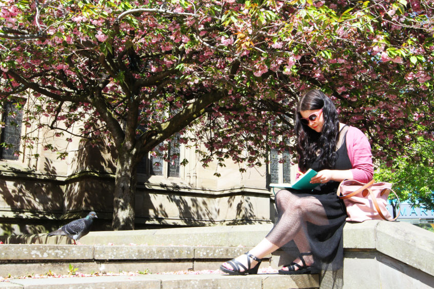 Jilly Noble enjoying the sun sitting under the cherry blossoms. Mhairi Edwards/DCT Media