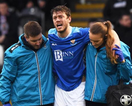 Murray Davidson is helped off at St Mirren.