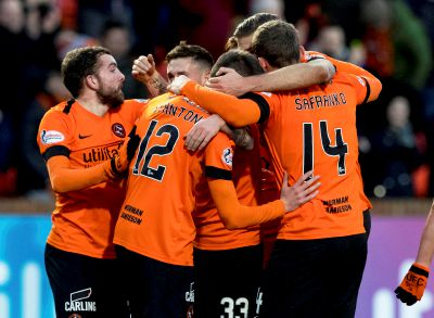 United's players celebrate Sam Stanton's opening goal.
