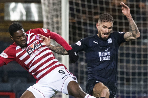 Martin Woods in action against Hamilton Accies.