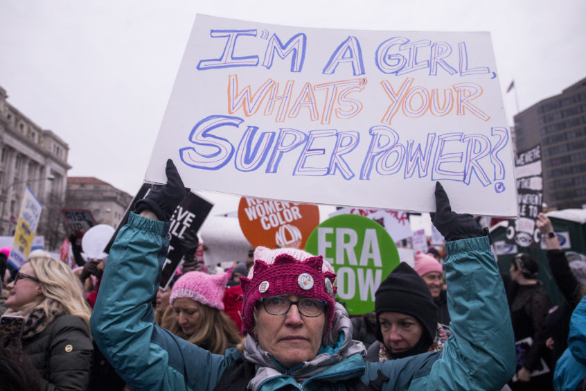 A demonstrator holds a sign during the 2019 Women's March in Washington, DC.