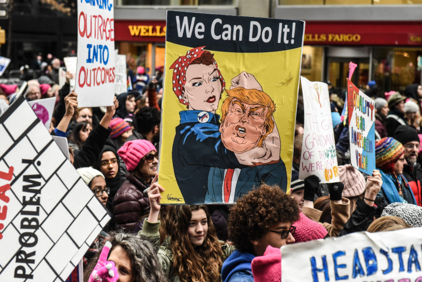 People participate in the Women's March in New York City. This year marked the third year of the Women's March which still drew large crowds in New York despite a public dispute between organisers.