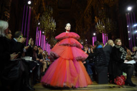 A heavily pregnant Erin O'Connor walks the Paris runway wearing a stacked pink tulle gown during the Schiaparelli Spring Summer 2019. Not your usual maternity dress.