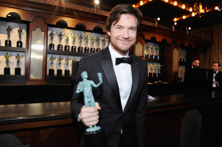 Jason Bateman celebrates winning Outstanding Performance by a Male Actor in a Drama Series for his performance in Ozark.