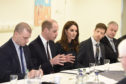 William and Kate meeting action group members.