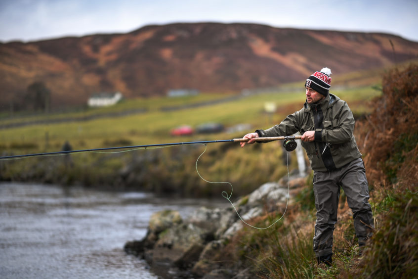 An Angler fishes during the opening of the salmon fishing season on the River Helmsdale in Helmsdale, Scotland. The river Helmsdale has been described as one of the best, if not the very best in the north of Scotland opening on the 11th of January and continuing through to the 30th of September it is one of the earliest rivers to open to fishermen in the UK.