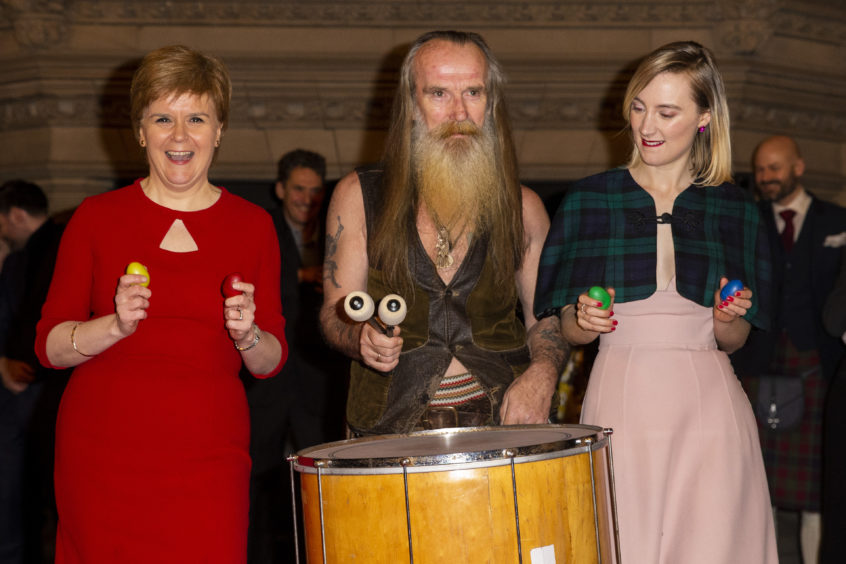 """First Minister Nicola Sturgeon and Saoirse Ronan dance with the band as they attend the Scotland premiere of """"Mary Queen of Scots"""" in Edinburgh."""