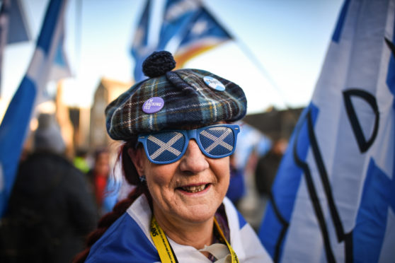 An independence supporter outside the Scottish Parliament in Edinburgh.