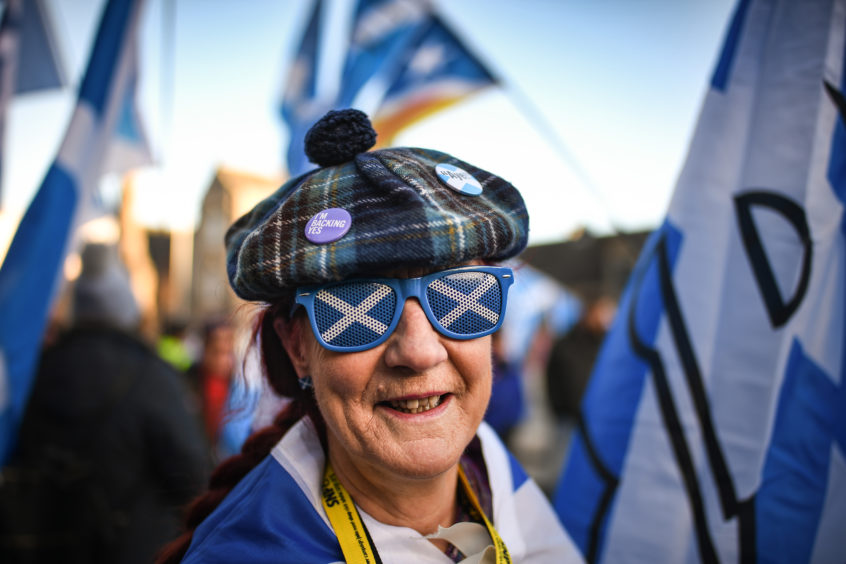 Independence supporters gather outside the Scottish Parliament in Edinburgh. Supporters for independence were making their voices heard as they feel support for a second independence referendum is growing due the Westminsters Brexit deal being voted down in parliament.