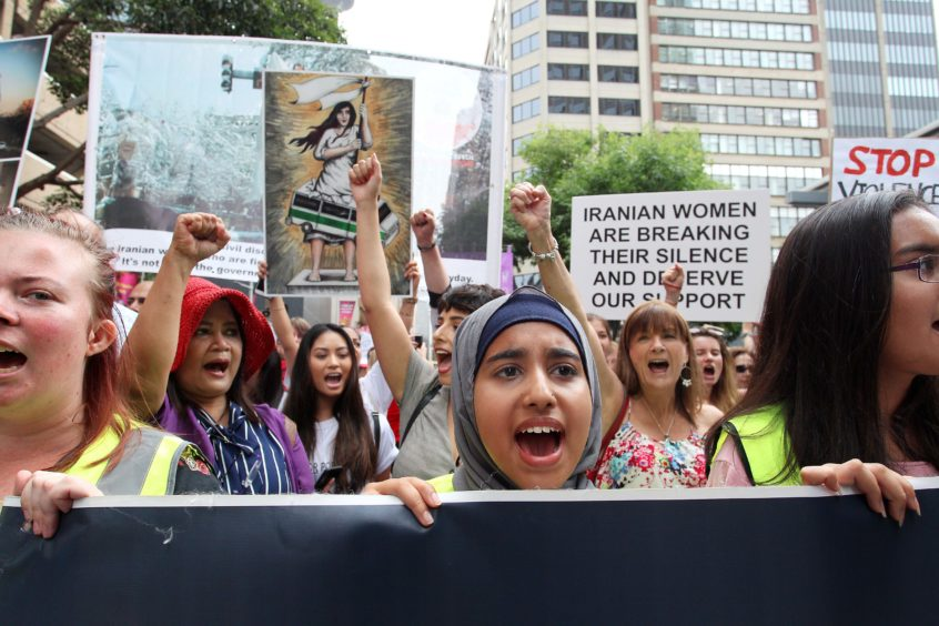 Protesters march towards Belmore Park during the 'Women's Wave' March in Sydney, Australia.