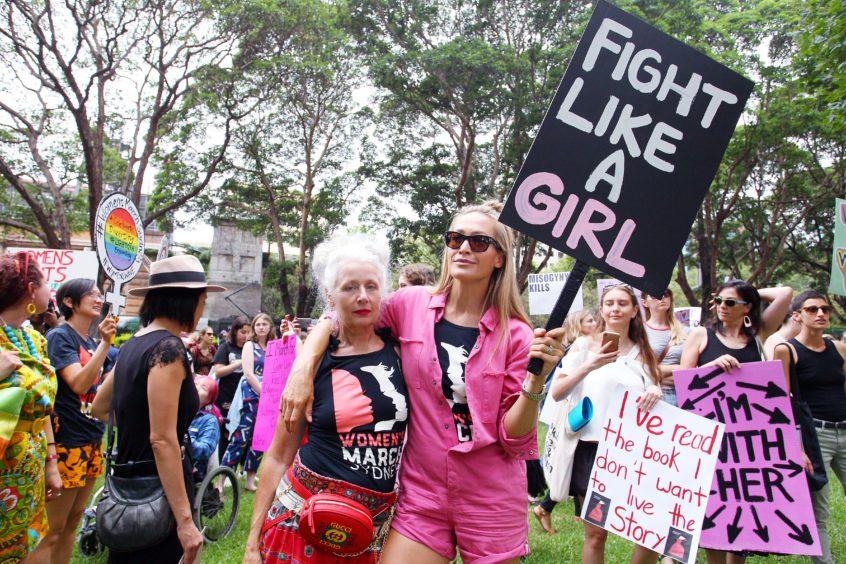Sarah Jane Adams and Erika Heynatz join the 'Women's Wave' March in Sydney, Australia.
