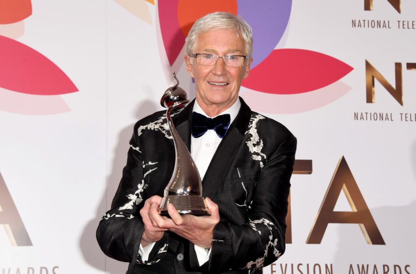Paul O'Grady with the award for Best Factual Entertainment Programme.