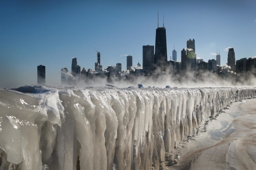 Ice covers the Lake Michigan shoreline in Chicago, Illinois. Businesses and schools have closed, Amtrak has suspended service into the city, more than a thousand flights have been cancelled and mail delivery has been suspended as the city copes with record-setting low temperatures.