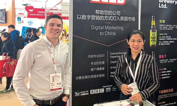 James Buchan and Xiaoxiao Zhang at Zudu stall at Food and Hotel China exhibition