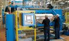 Technicians working on Rockwells multi-million-pound Rockstar machine.