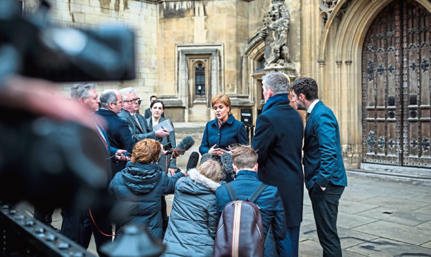 Leader of the Scottish National Party Nicola Sturgeon speaks to media outside the Houses of Parliament on January 16, 2019 in London.