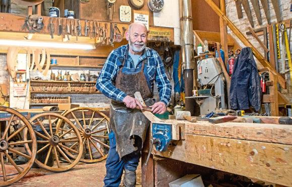 Ian Grant,67, Scotland's last wheelwright, in his workshop near Cupar.
