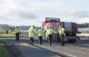 Investigators at the scene of the A90 crash.