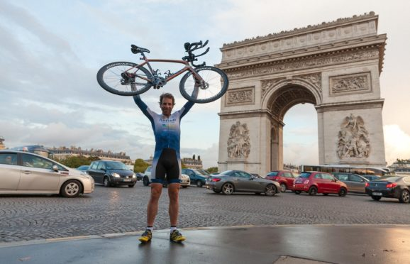 Mark Beaumont completed his record-breaking cycle around the world at the Arc De Triomphe in Paris in 2017