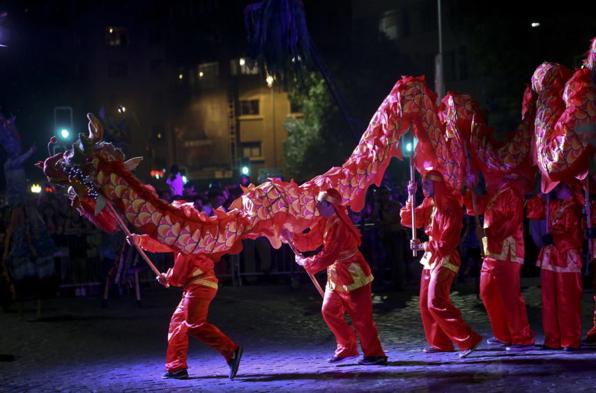 Dragon dancers take part in the inauguration performance.