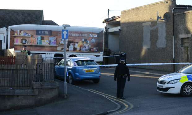 Police seal off the area around the shop after a lorry struck the rear of McColls of Methil.