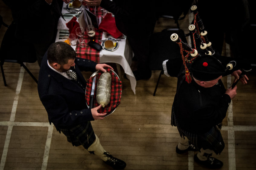 The Haggis making a traditional entrance with piper.