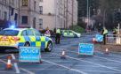 Police at Grampian Court, Perth.