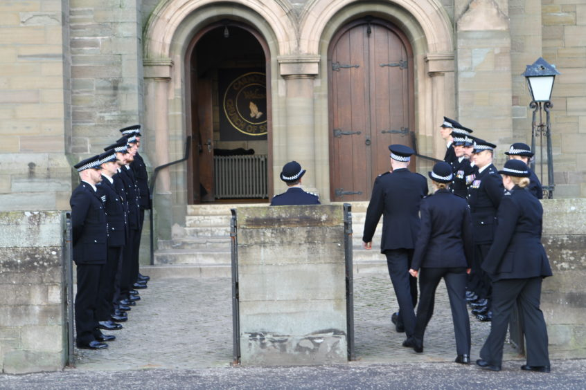 Officers line-up outside Carnoustie Church for the funeral of PC Dean Morrison.