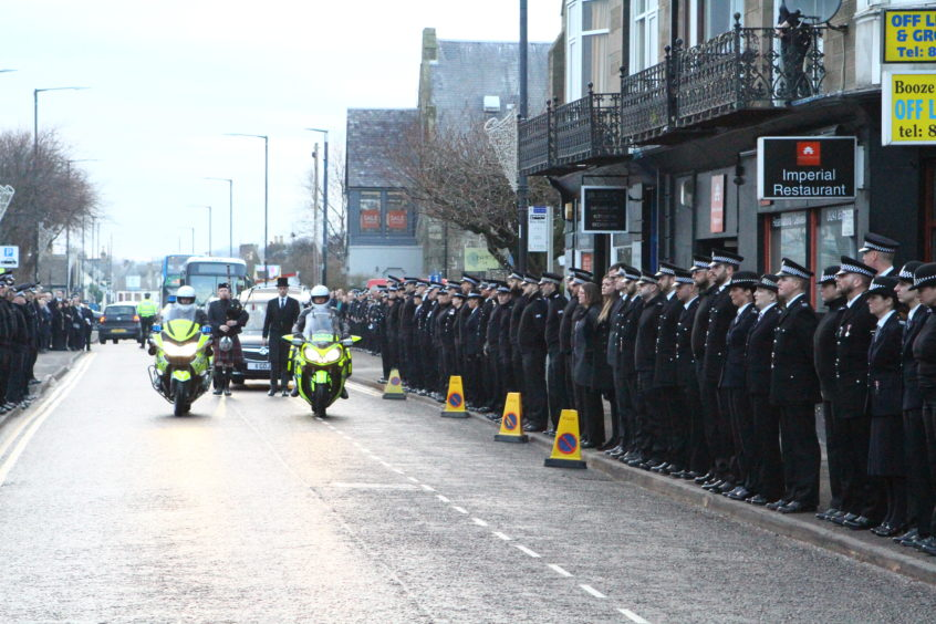 Officers line the streets of Carnoustie following the funeral of PC Dean Morrison.