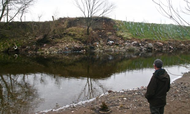Robert Kellie assesses beaver damage at River Ericht.