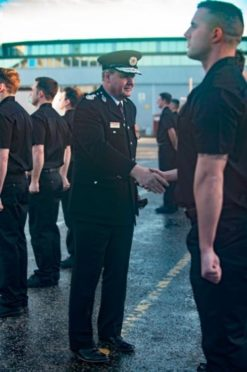 Chief Officer Alasdair Hay congratulates new recruits as they graduate at Thornton