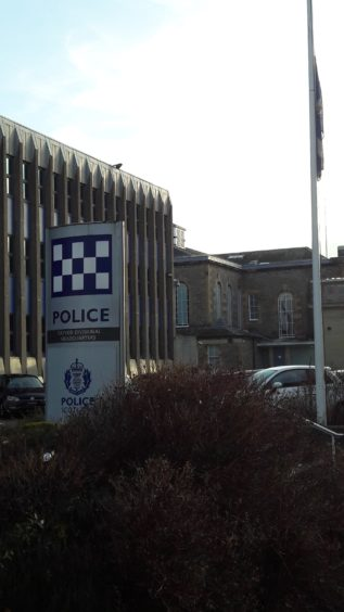The flag at half mast at Tayside Police Division's Dundee HQ.