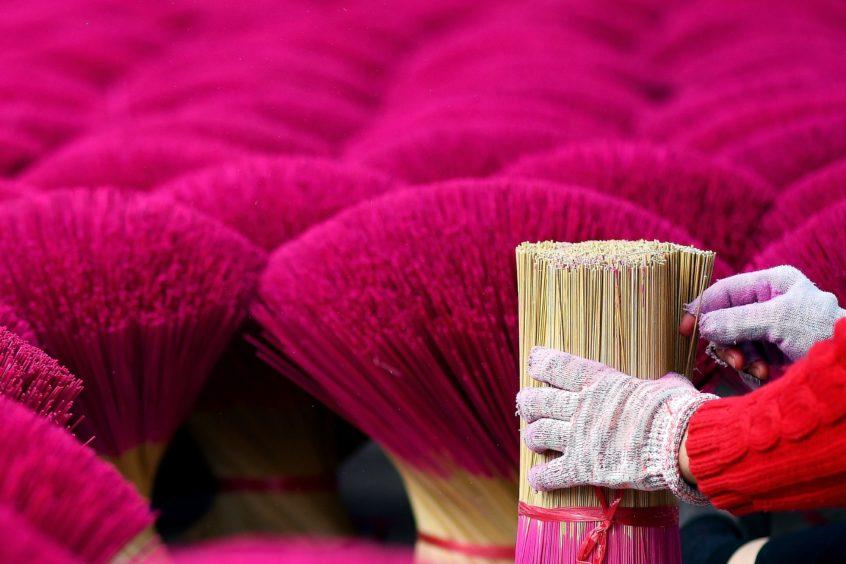 Picking incense sticks kept for drying.