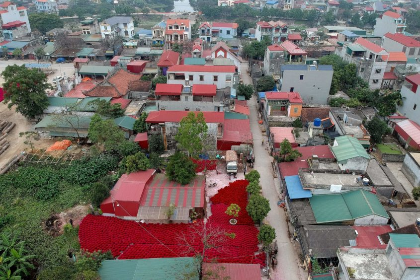 An aerial picture taken   shows incense sticks kept in a courtyard for drying in the village of Quang Phu Cau on the outskirts of Hanoi.