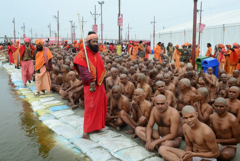 Newly initiated 'Naga Sadhus' (Hindu holy men) sit as they perform rituals on the banks of the Ganges River during the Kumbh mela festival, in Allahabad ,India. During every Kumbh Mela, the diksha, a ritual of initiation by a guru takes place for new members.