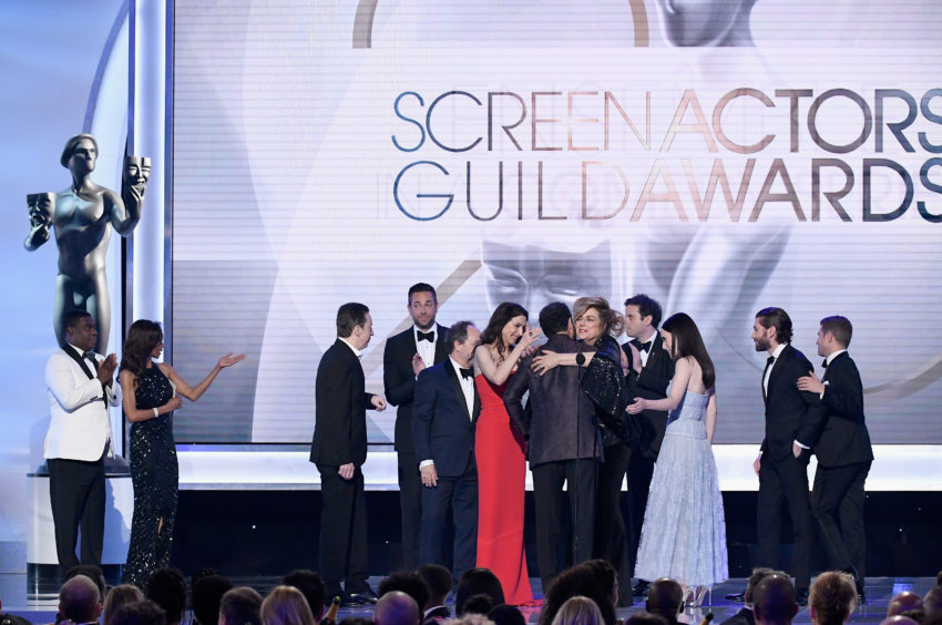 Cast members of The Marvelous Mrs. Maisel accept the Outstanding Performance by an Ensemble in a Comedy Series award onstage during the 25th Annual Screen ActorsGuild Awards.