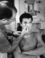 "Tony Curtis getting make up applied by Emile LaVigne on the set of ""Some Like It Hot"" in 1958 in Los Angeles"