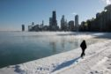 A man takes a walk along the city's lakefront as temperature hung around -20 degrees in Chicago, Illinois. Businesses and schools have closed, Amtrak has suspended service into the city, more than a thousand flights have been cancelled and mail delivery has been suspended as the city copes with record-setting low temperatures.