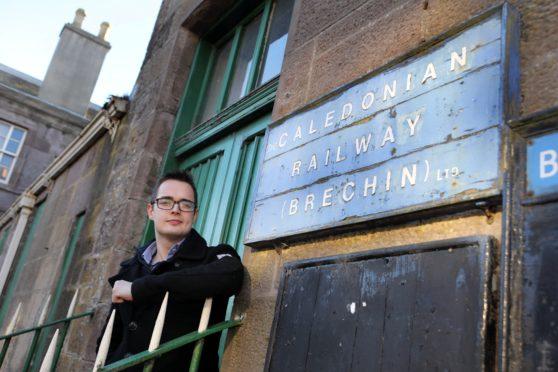 Braden Davy at Brechin Railway Station, is making a bid to bring back Beeching railways.