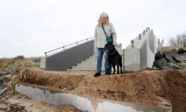 "Marilyn Mauran walking her dog ""Ben"" on Broughty esplanade."