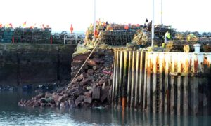 The collapsed wall at Arbroath Harbour.